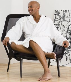 Man showing off the TC22 towel city bath robe in white.