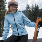 Result Soft Shell work jacket also great for skiing. Lady wearing pale blue while skiing.
